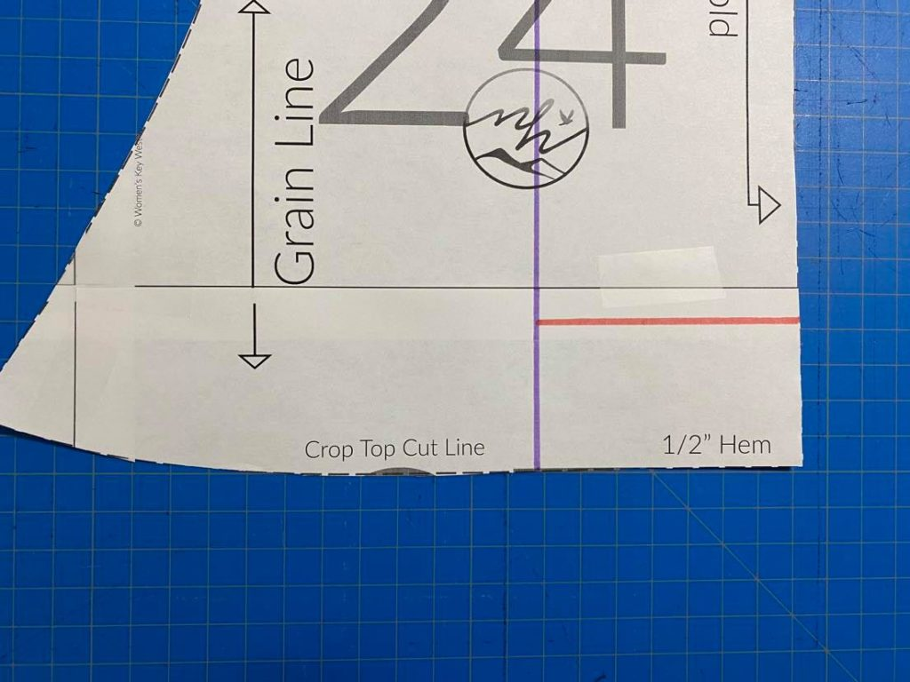 Draw line a few inches above hem from center line to fold line